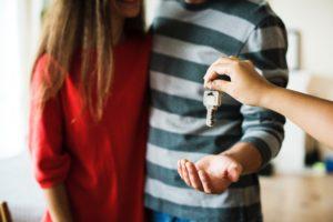 handing over keys to tenants