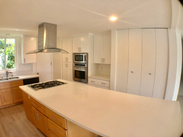 The spacious renovated kitchen in a luxury residence we manage
